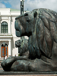 Bronze lions guarding canal in central Gothenburg Sweden
