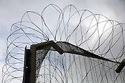Security fencing around a category C prison. HMP Downview.