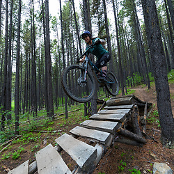 Pete Hoang hitting a jump on Race of Spades at Moose Mountain in Alberta, Canada