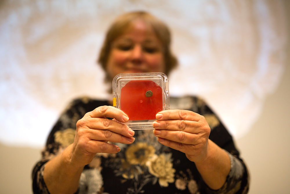 Dr. Eilat Mazar, an Israeli Archeologist of the Hebrew University, holds and displays a clay imprint, known as a bulla, which was discovered and unearthed from excavations near the Old City of Jerusalem, and later revealed to be from the seal of the biblical King Hezekiah, during a press conference at The Hebrew University in Jerusalem, on December 2, 2015.