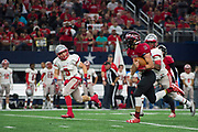 Clayton Kent #11 of the Iraan High School football team breaks free during the state championship game at AT&T Stadium in Arlington, Texas on December 15, 2016. (Cooper Neill for The New York Times)