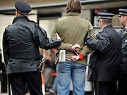 © Licensed to London News Pictures. 11/11/2011. London, UK. A man is handcuffed by police officers.  Police arrest members of the EDL near the Cenotaph following a Remembrance Day service today (11/11/2011). A large group of EDL members where arrested. Police a. Photo credit : Stephen Simpson/LNP
