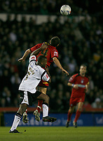 Richard Garcia of Colchester rises above Michael Johnson of Derby