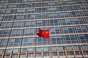 Chinese flag flying on Beijing Financial Street or BFS (often called China's Wall Street) is an area which offers a collaborative environment for foreign and domestic financial institutions and Chinese regulatory agencies. It is part of the city's strategic plan to position Beijing as a domestic centre for business and finance. The area is gaining prominence as an internationally influential business and financial district.