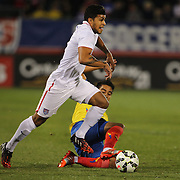 DeAndre Yedlin, (left), USA, dribble past Christian Noboa, Ecuador, during the USA Vs Ecuador International match at Rentschler Field, Hartford, Connecticut. USA. 10th October 2014. Photo Tim Clayton