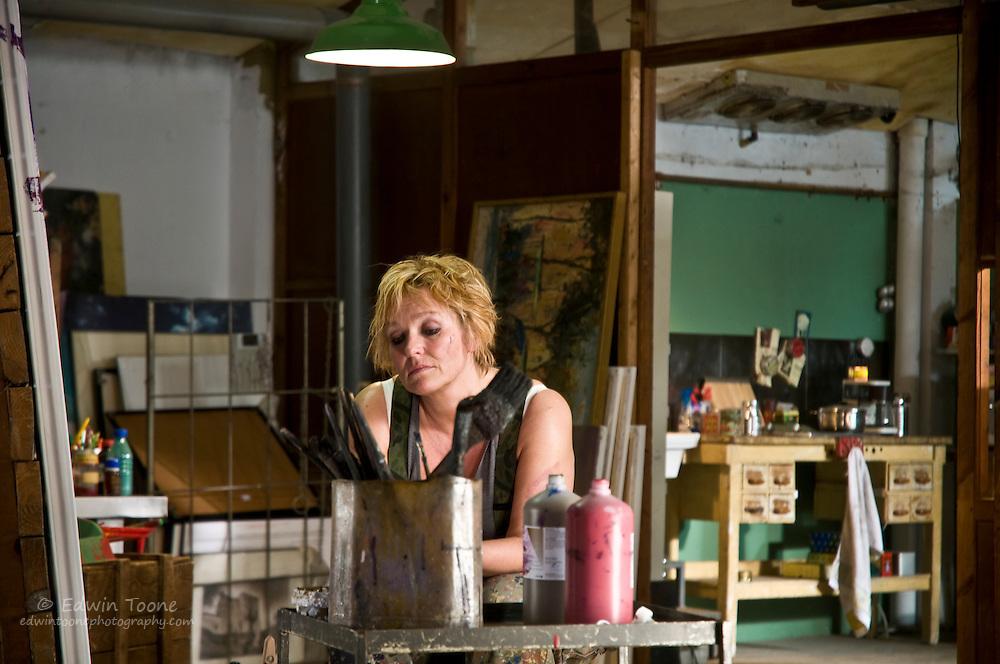 Asta working in her studio apartment.