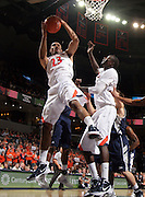 CHARLOTTESVILLE, VA- December 3: Mike Scott #23 of the Virginia Cavaliers grabs a rebound during the game against the Longwood Lancers on December 27, 2011 at the John Paul Jones Arena in Charlottesville, Virginia. Virginia defeated Longwood 86-53. (Photo by Andrew Shurtleff/Getty Images) *** Local Caption *** Mike Scott
