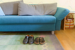 Sofa in living room with shoes