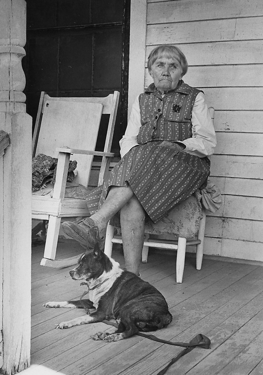 ©1978 Woman on her front porch, Hearne, Texas