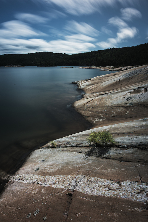 A 302-second exposure of McGregor Bay, Ontario -- with rocks smoothly sculpted by the glaciers