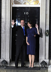 © under license to London News Pictures. LONDON. 05/05/2011. One year on since the last General Election. FILE PICTURE DATED.11/05/10. David Cameron and his wife Samantha on the steps of Number 10 Downing Street. British Prime Minister Gordon Brown has resigned his position and David Cameron has become the new British Prime Minister on May 11, 2010. The Conservative and Liberal Democrats are to form a coalition government after five days of negotiation. Photo credit should read Stephen Simpson/LNP