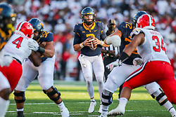Sep 4, 2021; College Park, Maryland, USA; West Virginia Mountaineers quarterback Jarret Doege (2) drops back to pass during the fourth quarter against the Maryland Terrapins at Capital One Field at Maryland Stadium. Mandatory Credit: Ben Queen-USA TODAY Sports