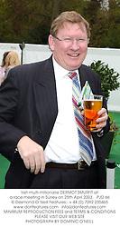 Irish multi-millionaire DERMOT SMURFIT at a race meeting in Surrey on 25th April 2003.PJD 66
