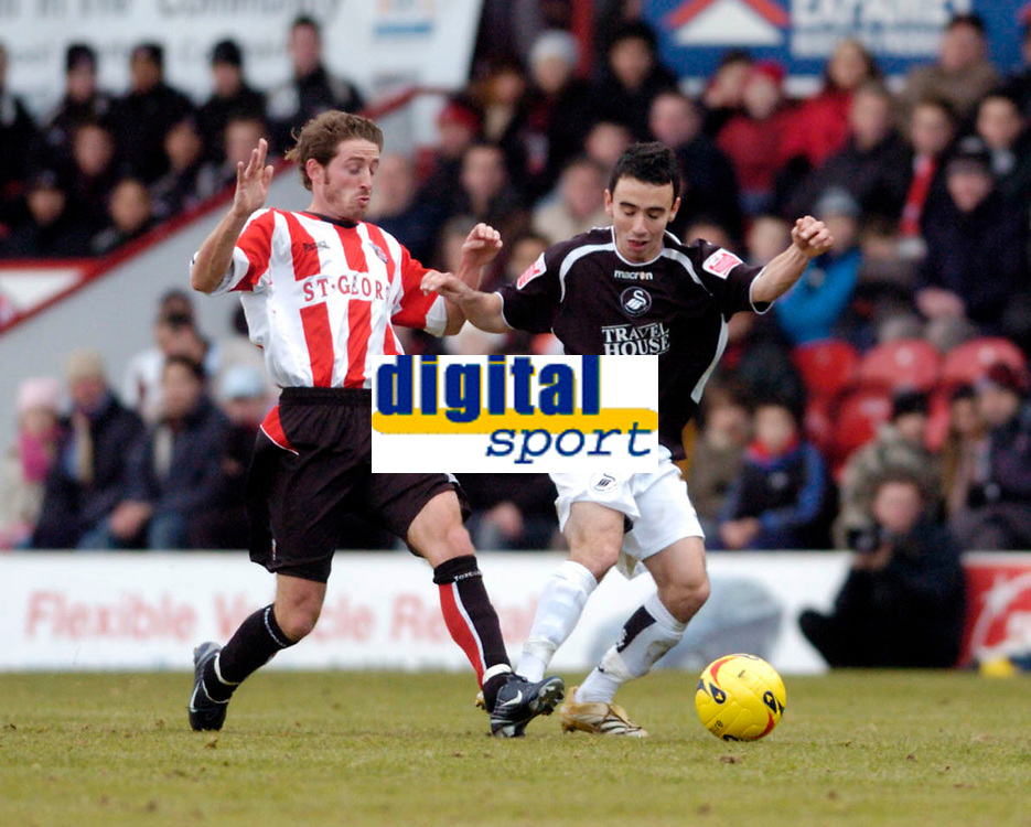Photo: Leigh Quinnell.<br /> Brentford v Swansea City. Coca Cola League 1.<br /> 26/12/2005. Brentfords Paul Brooker clashes with Swanseas Leon Britton.