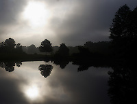 Morning Reflection Silhouette at Sourland Mountain Reserve. Early Summer in New Jersey. Image taken with a Leica X1 (ISO 100, 24 mm, f/6.3, 1/1250 sec). Raw image processed with Capture One Pro and Photoshop CS5.