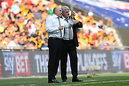 Steve Bruce, the Hull City manager ® talking to Mike Phelan, the Hull City assistant manager on the touchline during the 1st half. Skybet football league Championship play off final match, Hull city v Sheffield Wednesday at Wembley Stadium in London on Saturday 28th May 2016.<br /> pic by John Patrick Fletcher, Andrew Orchard sports photography.