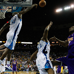 April 24, 2011; New Orleans, LA, USA; New Orleans Hornets center Emeka Okafor (50) blocks a shot by Los Angeles Lakers power forward Lamar Odom (7) during the fourth quarter in game four of the first round of the 2011 NBA playoffs at the New Orleans Arena. The Hornets defeated the Lakers 93-88.   Mandatory Credit: Derick E. Hingle