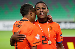 Jeroen Lumu of Netherlands and Djavan Anderson of Netherlands celebrate after winning the UEFA European Under-17 Championship Final match between Germany and Netherlands on May 16, 2012 in SRC Stozice, Ljubljana, Slovenia. Netherlands defeated Germany after penalty shots and became European Under-17 Champion 2012. (Photo by Vid Ponikvar / Sportida.com)