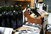 The fully manual labelling station where a vineyard worker hand labels all bottles. Bodega Vinos Finos H Stagnari Winery, La Puebla, La Paz, Canelones, Montevideo, Uruguay, South America