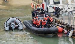 © Licensed to London News Pictures. 28/04/2021. Dover, UK. Migrants are helped ashore by Border Force officers at Dover Harbour in Kent after crossing the English Channel. Photo credit: Stuart Brock/LNP