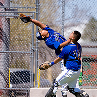 032913       Brian Leddy<br /> Laguna-Acoma Hawks Isaac Gallegos (19) and Trent Fernando (14) chases down a foul ball during Friday's tournament game against Hatch Valley.