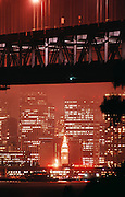 The Ferry Building and downtown San Francisco, California, seen under the San Francisco/ Oakland Bay Bridge.