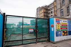 London, UK. 13th January, 2018. Gates to the construction site at the former St James's Gardens which has been closed to facilitate work on the HS2 high-speed rail link. Around 50 London Plane, Common Ash, Italian Alder, Common Lime, Bird Cherry, Wild Cherry and Sugar Maple trees in St James's Gardens have been felled as part of preparations for HS2 and an estimated 30,000-60,000 bodies will be exhumed from the cemetery there.