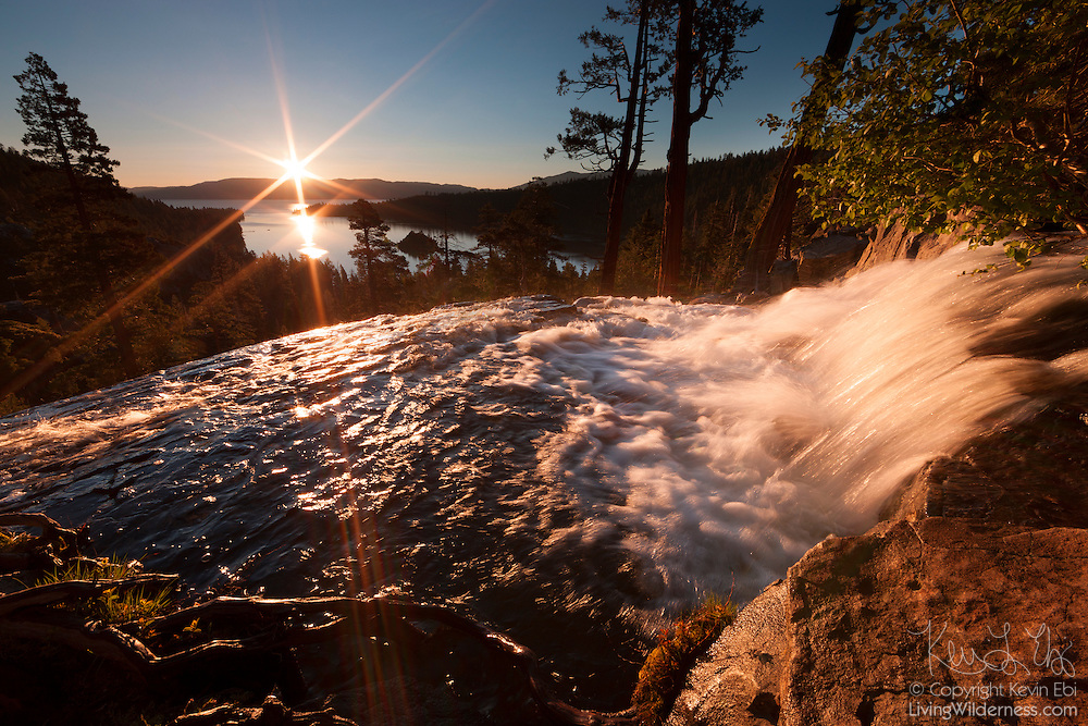 The sunrise lights up Eagle Falls which flows high above Emerald Bay and Lake Tahoe on the border of California and Nevada. Lake Tahoe is the second deepest lake in the United States and the sixteenth deepest in the world, with a maximum depth of 1,645 feet (501 meters). The lake was formed by a fracture in the Earth's crust that resulted in the Sierra Nevada mountains and Carson Range (visible in the background).