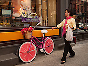 A colorful bicycle outside of L'Occitane, a shop in ShoHo's Prince Street.