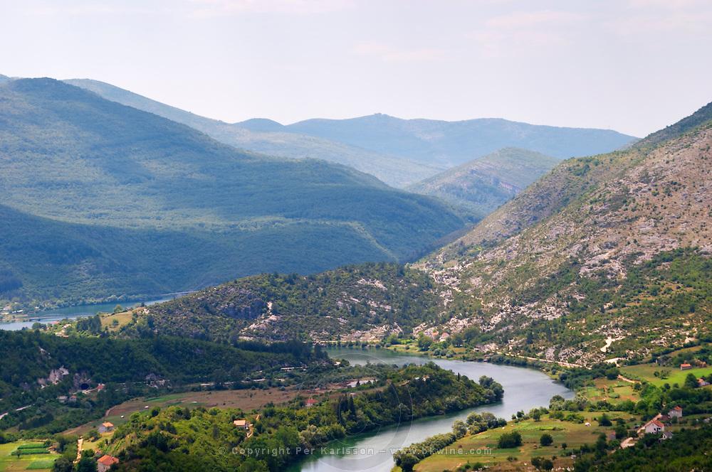 A panoramic view across the tremendously impressive Orin or Bijela Gora mountain tops close to the border to Montenegro on the road between Trebinje and Niksic. View of the river Trebisnjica in a steep valley.. Trebinje. Republika Srpska. Bosnia Herzegovina, Europe.