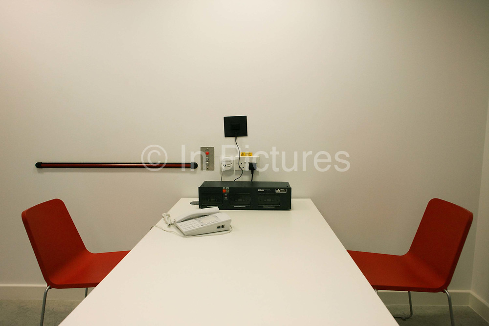 """Two seats, three tape-recorders, a panic strip and a telephone are seen in the UK Border Agency's immigration detention room at Heathrow Airport's Terminal 5. Officers deal with members of the public whose passports, demeanour or travel habits have drawn attention to possible criminal activity while seeking entry into the United Kingdom. On average, 10 a day are refused entry here and between 2008 and 2009, 33,100 people were detained at the airport for mainly passport irregularities. The UK Border Agency is responsible for securing the United Kingdom borders and controlling migration in the UK. They manage border control enforcing immigration and customs regulations and consider applications for permission to enter the UK for citizenship and asylum. From writer Alain de Botton's book project """"A Week at the Airport: A Heathrow Diary"""" (2009). ..."""