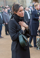 Meghan Markle meets members of the public during a walkabout as she visits Cardiff Castle.