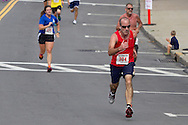 Middletown, New York - Runners near the finish line on West Main Street at the Run 4 Downtown road race in Middletown, N.Y.