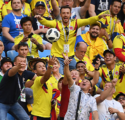 June 28, 2018 - Samara, Russia - Fans stretch to reach the ball fallen on the grandstand during the 2018 FIFA World Cup Group H match between Colombia and Senegal in Samara. (Credit Image: © Chen Cheng/Xinhua via ZUMA Wire)