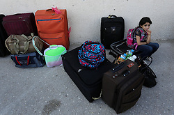 August 16, 2017 - Gaza City, Gaza Strip, Palestinian Territory - Palestinians wait for travel permits to cross into Egypt through the Rafah border crossing after it was opened by Egyptian authorities for humanitarian cases, in Rafah in the southern Gaza Strip on August 16, 2017  (Credit Image: © Ashraf Amra/APA Images via ZUMA Wire)