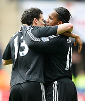 Photo: Steve Bond/Richard Lane Photography.<br />Coventry City v Chelsea. FA Cup 6th Round. 07/03/2009. Michael Ballack (L) and Didier Drogba celebrate