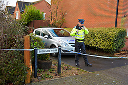 © Licensed to London News Pictures.  03/12/2012. BICESTER, UK. A Police Community Support Officer (PCSO) guards the scene of a murder in Lucerne Aveneue, Bicester. 31 year old Janee Parsons was found with multiple stab wounds on Saturday (1st Dec) morning and later died in hospital. A 38-year-old man has been arrested on suspicion of murder and is currently in police custody. Photo credit :  Cliff Hide/LNP