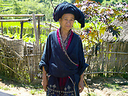 Portrait of a Iu Mien (Yao) ethnic minority woman wearing her traditional clothing in Ban Hom Phan village, Houaphan province, Lao PDR. One of the most ethnically diverse countries in Southeast Asia, Laos has 49 officially recognised ethnic groups although there are many more self-identified and sub groups. These groups are distinguished by their own customs, beliefs and rituals.