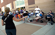 """A production assistant gives instructions to people waiting in line for an open casting call for season 11 of """"The Biggest Loser"""" television show in Broomfield, Colorado July 17, 2010. Clark arrived at 4:30 in the morning for a chance to be on the show and win $250,000.  Over 600 people attended the casting call.   REUTERS/Rick Wilking (UNITED STATES)"""