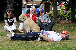 Orpington, UK  29/04/2011. The Royal Wedding of HRH Prince William to Kate Middleton..Street party,Hillview Crescent,Orpington,South East London, celebrating the Royal Wedding..Dave Smith (resident) having a sleep its been a long day!.Photo credit should read Grant Falvey/LNP. Please see special instructions. © under license to London News Pictures