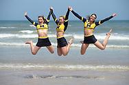 Michigan cheerleaders pose on the beach after winning the Coed Intermediate I division of the NCA & NDA Collegiate Cheer and Dance Championship in Daytona Beach, Fla., Friday, April 10, 2015.(AP Photo/Phelan M. Ebenhack)