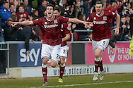Northampton Town Striker John Marquis celebrates his goal  during the Sky Bet League 2 match between Northampton Town and Cambridge United at Sixfields Stadium, Northampton, England on 12 March 2016. Photo by Dennis Goodwin.