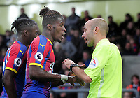 Football - 2018 / 2019 Premier League - Crystal Palace vs. Newcastle United<br /> <br /> Wilfried Zaha of Palace argues his point to the linesman, at Selhurst Park.<br /> <br /> COLORSPORT/ANDREW COWIE