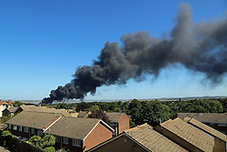 © Licensed to London News Pictures. 31/08/2013.  Smoke plumed acoss Gravesend today and over 10 fire appliances were called to the scene when an industrial fire broke out on the Gravesend riverside Credit : Rob Powell/LNP