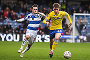 Leeds United Midfielder Jack Clarke (47) and Queens Park Rangers Midfielder Josh Scowen (11) battle for the ball during the The FA Cup match between Queens Park Rangers and Leeds United at the Loftus Road Stadium, London, England on 6 January 2019.