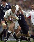 Twickenham, Surrey, 22nd March 2003,  RFU Twickenham Stadium, England, [Mandatory Credit; Peter Spurrier/Intersport Images]<br /> <br /> RBS Six Nations Rugby England v Scotland<br /> Scotland Full back Glenn Mefcalfe tackle Josh Lewsey.