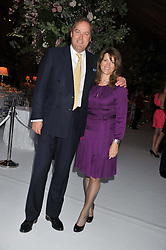 The HON.HARRY HERBERT and his wife CHICA at a dinner hosted by Cartier following the following the opening of the Chelsea Flower Show 2012 held at Battersea Power Station, London on 21st May 2012.