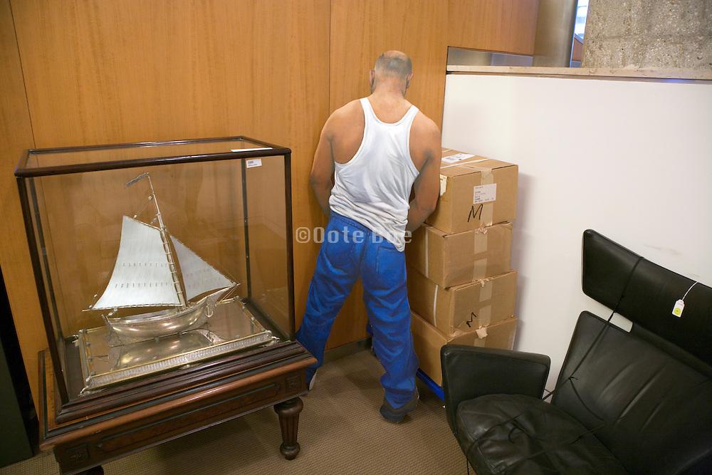 cardboard cutout of man urinating in a corner