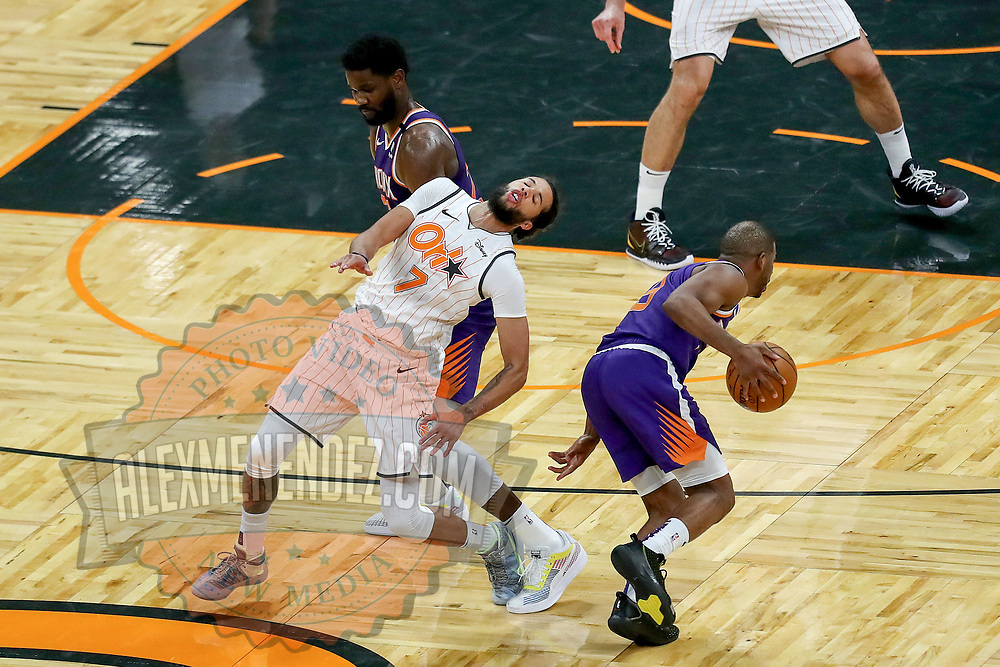 ORLANDO, FL - MARCH 24: Deandre Ayton #22 of the Phoenix Suns fouls Michael Carter-Williams #7 of the Orlando Magic as Chris Paul #3 of the Phoenix Suns dribbles past during the second half at Amway Center on March 24, 2021 in Orlando, Florida. NOTE TO USER: User expressly acknowledges and agrees that, by downloading and or using this photograph, User is consenting to the terms and conditions of the Getty Images License Agreement. (Photo by Alex Menendez/Getty Images)*** Local Caption *** Deandre Ayton; Michael Carter-Williams; Chris Paul