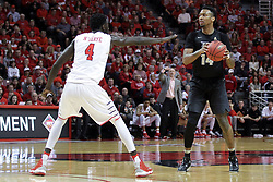 """20 March 2017:  Nick Banyard defended by Daouda """"David"""" Ndiaye (4) during a College NIT (National Invitational Tournament) 2nd round mens basketball game between the UCF (University of Central Florida) Knights and Illinois State Redbirds in  Redbird Arena, Normal IL"""